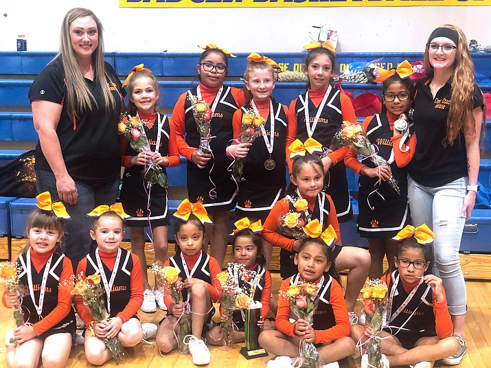 The Williams Youth Football cheerleaders compete at the Northern Arizona Youth Football Cheer Competition in Prescott Nov. 16. The cheer squad, coached by Melonie Daly and Charlene Reidhead, came home with a third place trophy. (Darcie Jensen/photo)