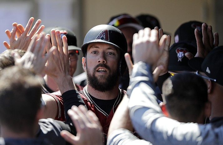 Arizona Diamondbacks' Steven Souza Jr. is congratulated after scoring against the Chicago Cubs in the first inning of a spring training game Saturday, March 16, 2019, in Scottsdale. (Elaine Thompson/AP)