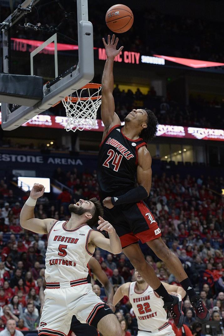 Louisville forward Dwayne Sutton (24) reaches for a rebound over Western Kentucky guard Camron Justice (5) during the first half of a game Friday, Nov. 29, 2019, in Nashville, Tenn. (Mark Zaleski/AP)