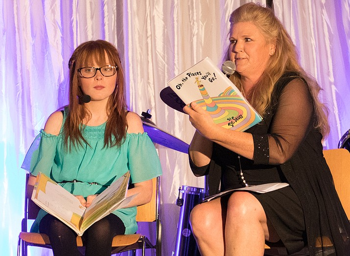 "YBBBS Executive Director Erin Mabery reads the Dr. Seuss classic ""Oh, the Places You'll Go!"" to Little Sister Julie during the gala. (YBBBS/Courtesy)"
