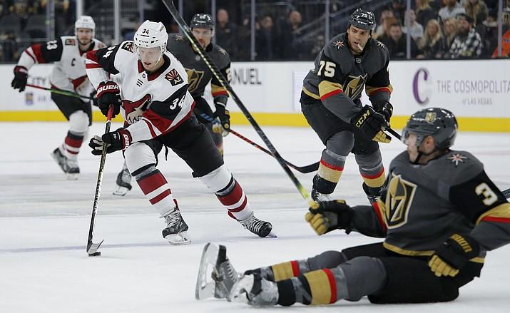 Arizona Coyotes center Carl Soderberg (34) skates around Vegas Golden Knights defenseman Brayden McNabb (3) during the first period of a game Friday, Nov. 29, 2019, in Las Vegas. (John Locher/AP)