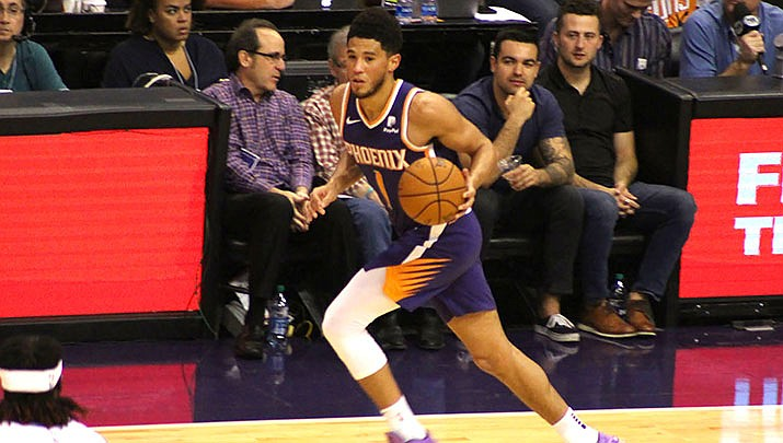 Devin Booker broke out of a perimeter-shooting slump, scoring 21 of his season-high 44 points in the third quarter Thursday night as the Suns tallied a 139-132 overtime victory over the Pelicans. (Miner file photo)