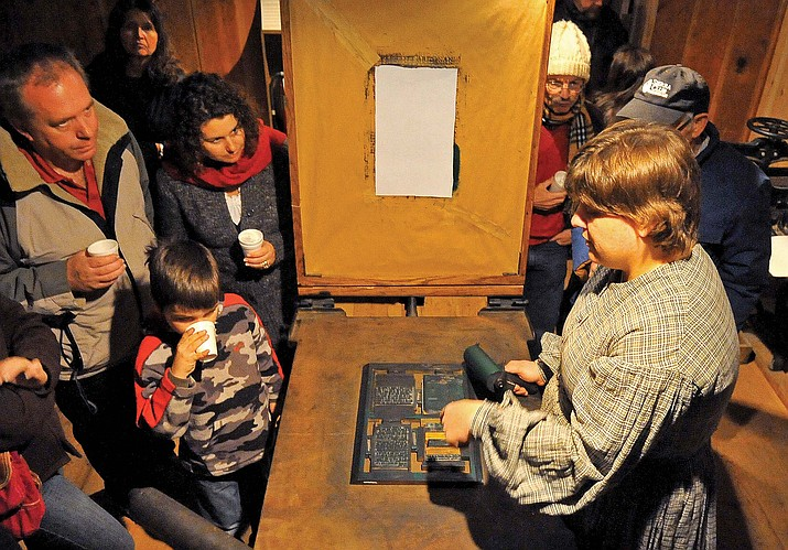 Misty Guille demonstrates how to use a Washington Press during Sharlot Hall Museum's Frontier Christmas in Prescott. This particular Washington Press was used to print the Sacramento Bee around 1867. (Courier file)