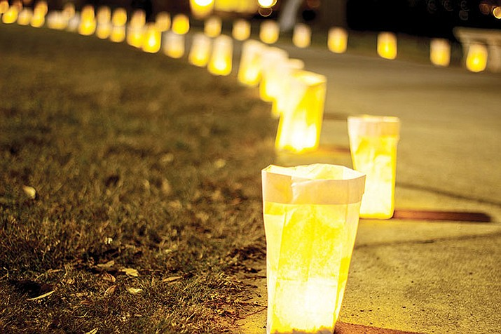 "Enjoy the holiday season at Yavapai College, 1100 E. Sheldon St., as the scenic sculpture garden glows with holiday cheer during the ""Light Up the Season"" Luminaria event Saturday, Dec. 7."