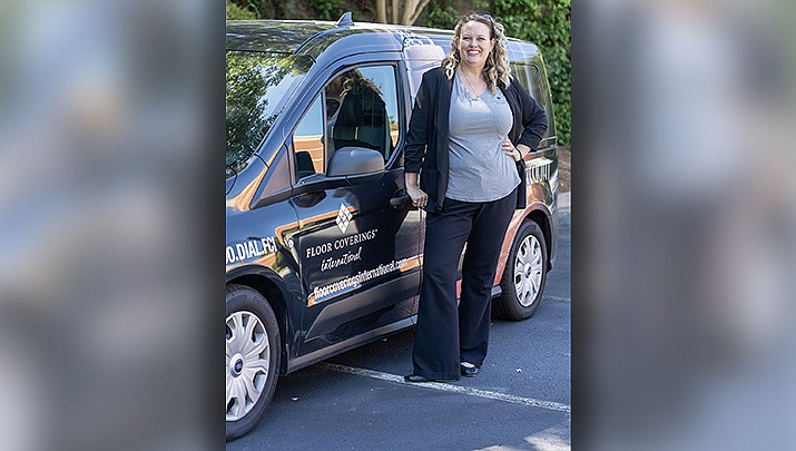 Krista Farney stands by her Floor Coverings International van. (Courtesy photo)