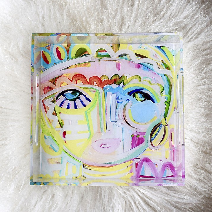"""This photo provided by fine artist Windy O'Connor shows one of her """"Tropicana Chica"""" acrylic trays. O'Connor likes giving small home accessories like this tray as holiday gifts because the recipient can use them in so many different ways, from decorating a coffee table to serving cookies or desserts at a party. (Windy O'Connor via AP)"""