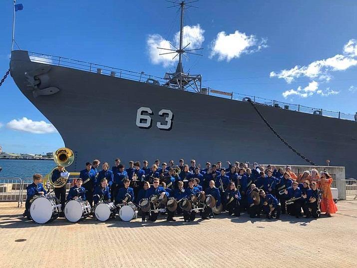 The Prescott High School Pride of Prescott Marching Band is seen alongside the USS Missouri. (PUSD/ Courtesy)