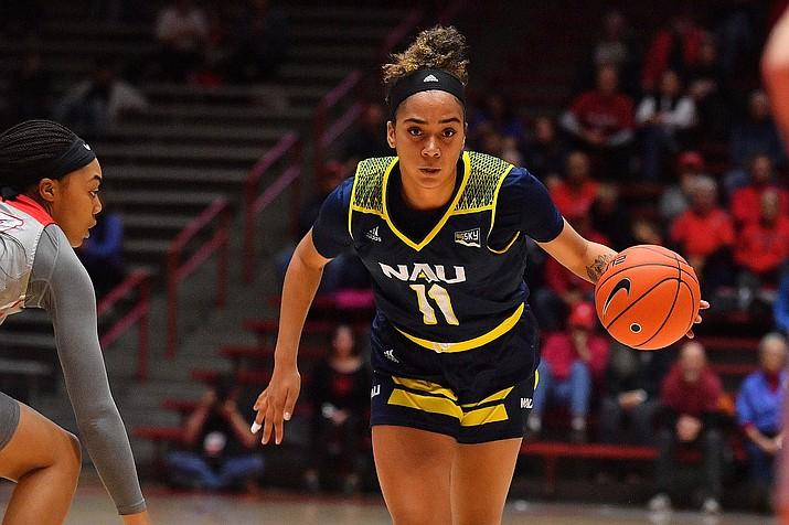 NAU guard Jacey Bailey (11) dribbles the ball in a game against New Mexico on Friday, Nov. 8, 2019, in Albuquerque, N.M. (NAU Athletics/Courtesy)