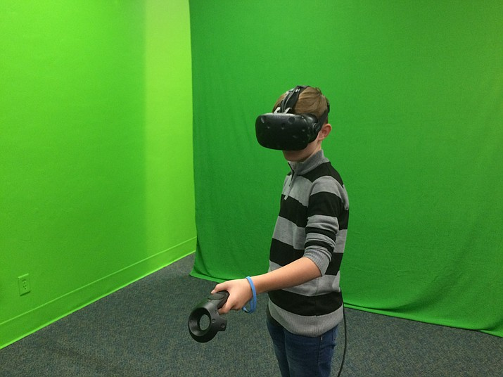 A student tries out The Lab's virtual reality equipment in the green screen area. (Nanci Hutson/Courier)