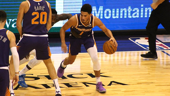 Devin Booker led the Suns with 35 points Saturday night in a 115-109 loss to the Houston Rockets. (Miner file photo)