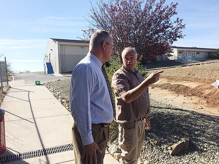 Mayer Superintendent, high school Principal Dean Slaga speaks with agriculture teacher Doug Martin as he supervises students on the school farm that includes animals, gardens and a workshop space. (Nanci Hutson/Courier)