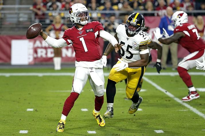 Arizona Cardinals quarterback Kyler Murray (1) throws as Pittsburgh Steelers linebacker Devin Bush pursues during the first half of an NFL football game, Sunday, Dec. 8, 2019, in Glendale, Ariz. (AP Photo/Rick Scuteri)