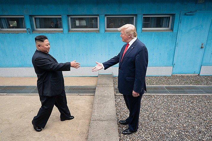 President Donald J. Trump shakes hands with Chairman of the Workers' Party of Korea Kim Jong Un Sunday, June 30, 2019, as the two leaders meet at the Korean Demilitarized Zone. (White House photo)