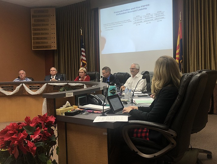 Members of the Prescott City Council get information on the annual report from the Public Safety Personnel Retirement System (PSPRS) during a meeting on Tuesday, Dec. 10, 2019. The report shows that Prescott's pension debt dropped by nearly $13 million for 2019. (Cindy Barks/Courier)