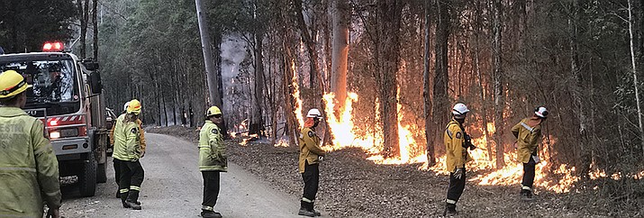 Firefighters in Australia conduct a burnout operation on a fire in New South Wales, Australia. (Elden Alexander/Bureau of Land Management)