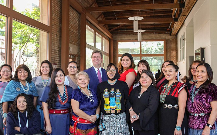 U.S. Rep. Greg Stanton, D-Phoenix, poses with the 16 most recent graduates of Project DreamCatcher, a partnership between the Freeport-McMoRan Foundation and the Thunderbird School of Global Management. Before their Nov. 22 graduation ceremony, Stanton spoke with the women about their businesses and plans. (Photo by Kalle Benallie/Cronkite News)