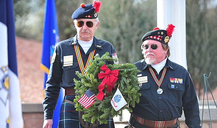 Members of Scottish American Military Society Post 1297 place a ceremonial wreath during the Wreaths Across America ceremony Dec. 15, 2018, as 2,106 veteran remembrance wreaths were placed at the Prescott National Cemetery. (Les Stukenberg/Courier, file)