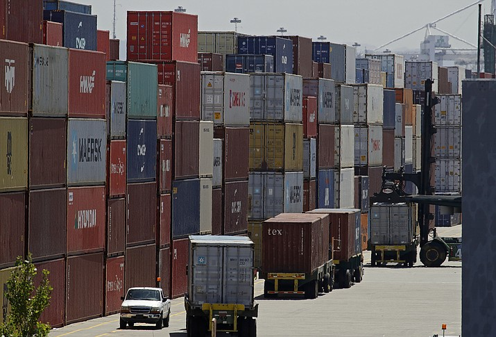 "In this July 22, 2019, image stacked containers wait to be loaded on to trucks at the Port of Oakland in Oakland, Calif. China's government says trade negotiators are in ""close communication"" with Washington ahead of a weekend deadline for a U.S. tariff hike. But a Ministry of Commerce spokesman gave no indication of possible progress in trade talks or whether Washington might postpone the increase. (Ben Margot/AP, File)"