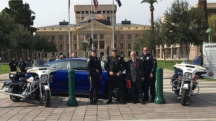This photo was taken during the Arizona GOHS DUI Enforcement Kick-Off press conference held at the Arizona State Capitol on Dec. 3. From left, standing in front of the new vehicle, are Cpl. Dan Spivey, Officer. Eric Urquijo, AZ GOHS Director Alberto Gutier and Sgt. David Reif. (Photo courtesy of KPD)