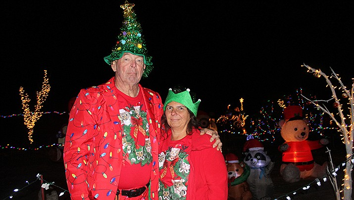 Chris Marie and Butch Meriwether pose by part of their Christmas display, which completely covers their 2.1-acre parcel in Golden Valley.