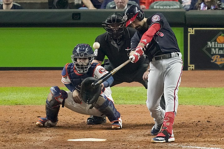 In this Oct. 29, 2019, file photo, Washington Nationals' Anthony Rendon hits a two-run home run against the Houston Astros during the seventh inning of Game 6 of the baseball World Series in Houston. An MVP finalist and a World Series champion, Rendon is clearly the crown jewel of this free agent class among position players - - although it is a reasonably strong group at third base this year. (Eric Gay/AP, file)