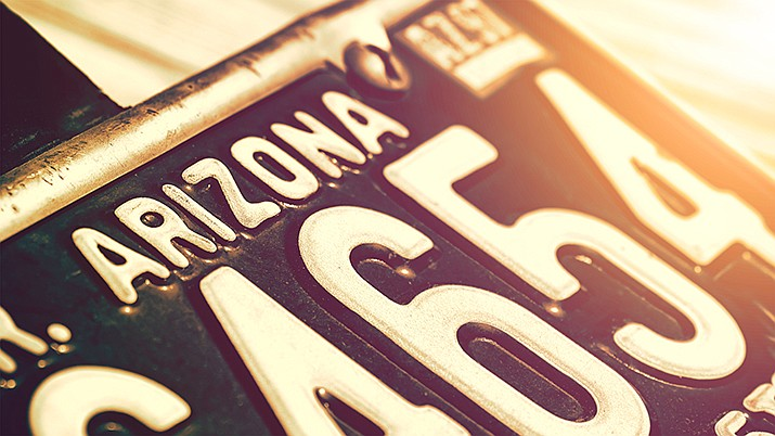 Beginning in January 2020, the Arizona Department of Transportation Motor Vehicle Division will begin sending all license plates, registration tabs and other documents such as vehicle titles through the mail only. (Miner file photo)