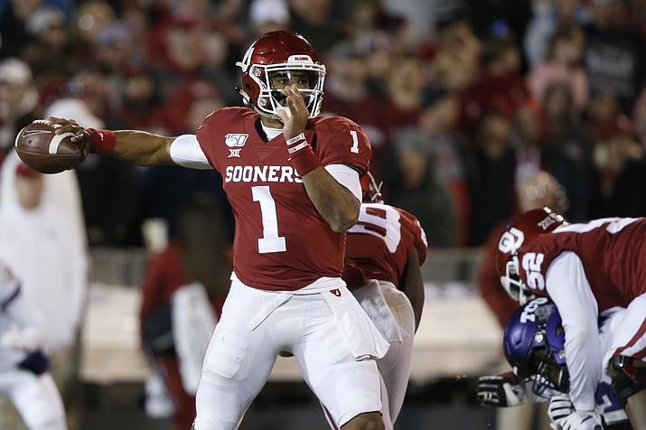 Oklahoma quarterback Jalen Hurts (1) passes in the first half of an NCAA college football game against TCU in Norman, Okla., Saturday, Nov. 23, 2019. (Sue Ogrocki/AP, file)