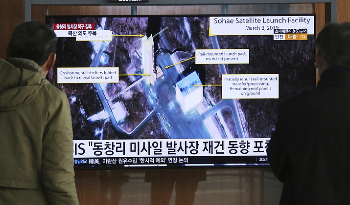 """In this March 6, 2019 photo, people watch a TV screen showing an image of the Sohae Satellite Launching Station in Tongchang-ri, North Korea, during a news program at the Seoul Railway Station in Seoul, South Korea. North Korea on Saturday, Dec. 14, says it successfully performed another """"crucial test"""" as its long-range rocket launch site that would further strengthen its """"reliable strategic nuclear deterrent.""""The signs read: """" North's Tongchang-ri launch site."""" (Ahn Young-joon/AP, File)"""