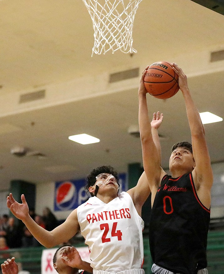 Lee Williams senior Jayden Hooper attempts a shot during a 56-38 loss to Coconino. (Photo courtesy of Cody Bashore/Arizona Daily Sun)