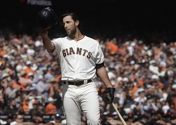 In this Sunday, Sept. 29, 2019, file photo, San Francisco Giants' Madison Bumgarner waves toward fans before pinch hitting against the Los Angeles Dodgers during the fifth inning of a baseball game in San Francisco. The Giants plan to meet with the free agent left-hander's representatives during the December 2019 baseball winter meetings in San Diego. (AP Photo/Jeff Chiu, File)