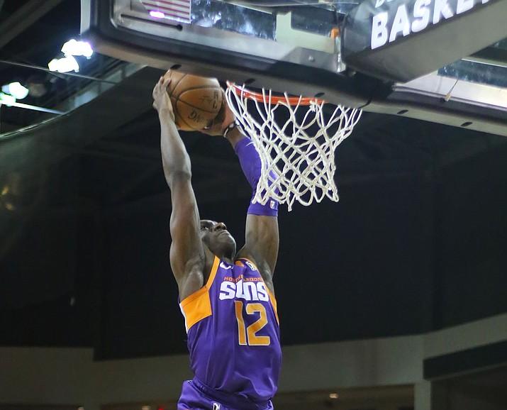 Northern Arizona Suns guard Jared Harper dunks against the Salt Lake City Stars Tuesday night at the Findlay Toyota Center. (Matt Hinshaw/NAZ Suns)
