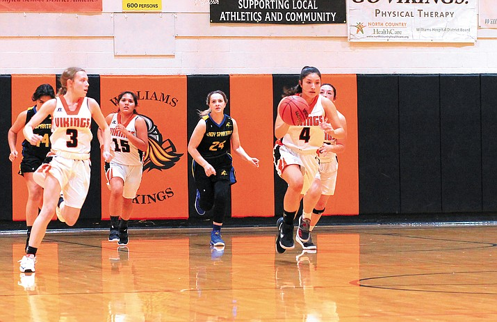 Aaliyah Alvardo heads down court after rebounding the ball in a game with Ash Fork Dec. 10. (Wendy Howell/WGCN)