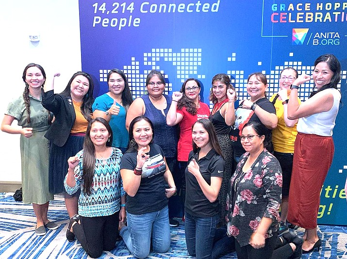 Navajo Technical University Electrical Engineering students Lasheena Ramone (Standing 4th from right) and Victoria Charlie (standing 3rd from left) join other women technologists for a photo at the 2019 Grace Hopper Celebration in Orlando, Florida.  (Photo courtesy of Navajo Technical University)