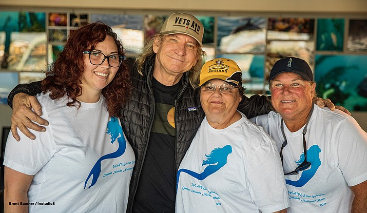 Eagles guitarist Joe Walsh greets veterans upon their return to Channel Islands National Park. The veterans were thrilled to meet him.  Walsh, a long time supporter of the Channel Islands, was at the park to meet with the superintendent. (Brent Sumner/Instudio8 via NPS)