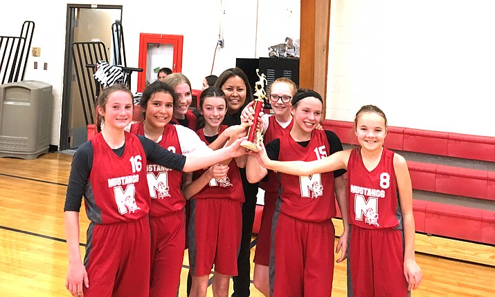 With a team of six seventh graders and one eighth grader, the Maine Consolidated School Mustangs won the I-40 League tournament Dec. 7 at Grand Canyon. The team consists of Kyleigh Amos, Stori Betts, Miranda Chaney, Madisyn Martinez, Kai Mortensen and Samantha Stafford. The team beat Chino Valley 38-10 and Grand Canyon 34-15 to secure the win. (Submitted photo)