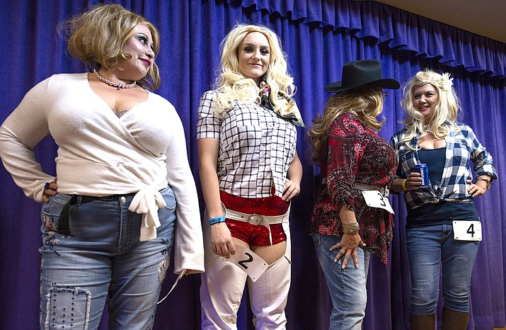 """A Dolly Parton look-alike contest throughout the evening during """"Urban Cowboy"""" night at the Elk's Lodge in Winslow Dec. 8. (Todd Roth/NHO)"""