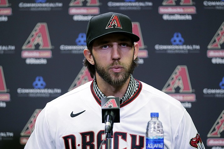Newly acquired Arizona Diamondbacks pitcher Madison Bumgarner speaks after being introduced during a team availability, Tuesday, Dec. 17, 2019, in Phoenix. (Matt York/AP)