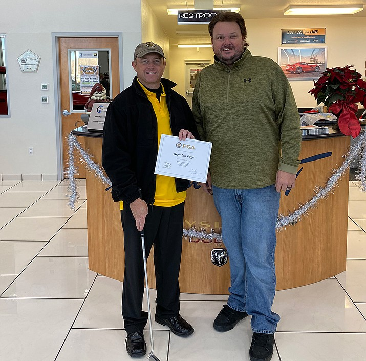 Brendan Page, left, poses with Cody Swanty at Martin Swanty Chrysler Dodge Jeep Ram. (Courtesy photo)