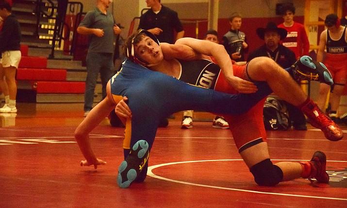 Mingus sophomore Dathan Wimer wrestles at 145 pounds against Kingman at home. VVN/James Kelley