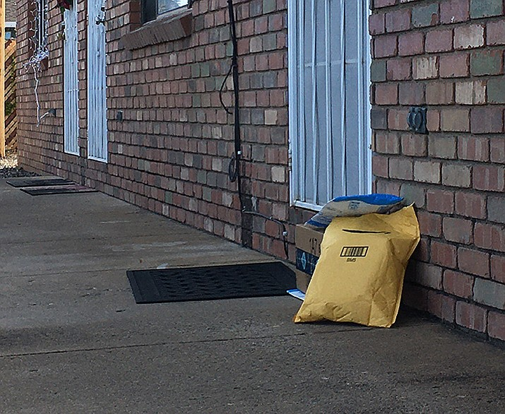 """A more and more common practice in this age of online shopping is """"porch pirates"""" who steal your packages after they are delivered to your home. (Matthew Van Doren/Courier)"""