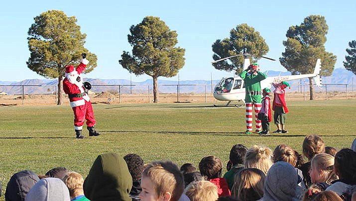 Santa Claus and elves arrived at Cerbat Elementary School promptly at 10 a.m. on Thursday, Dec 19. (Photo by Agata Popeda/Kingman Miner)