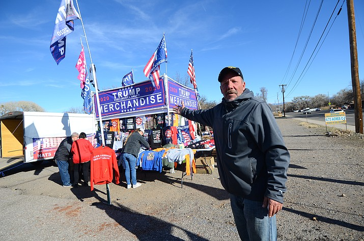 "Steve Goodman has set up a Trump merchandise stand in Cottonwood for a week and business is ""excellent."" VVN/Vyto Starinskas"