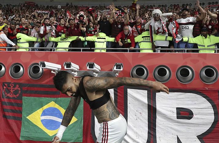 Flamengo's Gabriel Barbosa celebrates with Flamengo fans end of the Club World Cup semifinal match between Flamengo and Al Hilal at the Khalifa International Stadium in Doha, Qatar, Tuesday, Dec. 17, 2019. (Hassan Ammar/AP).