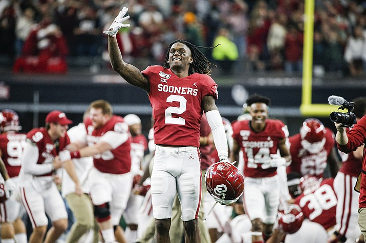 In this Dec. 7, 2019, photo, Oklahoma wide receiver CeeDee Lamb (2) celebrates a 30-23 overtime win against Baylor during the Big 12 Championship game, in Arlington, Texas. Lamb was selected to The Associated Press All-America team, Monday, Dec. 16, 2019. (Brandon Wade/AP, file)