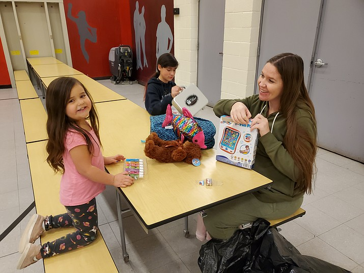 Grand Canyon School students received gifts from the Toys for Tots program Dec. 18. (Erin Ford/WGCN)