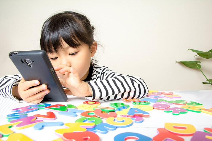 Fifty-three percent of children own a smartphone by age 11, and 84 percent of teenagers have their own phones, according to Common Sense Media. (Stock Photo)