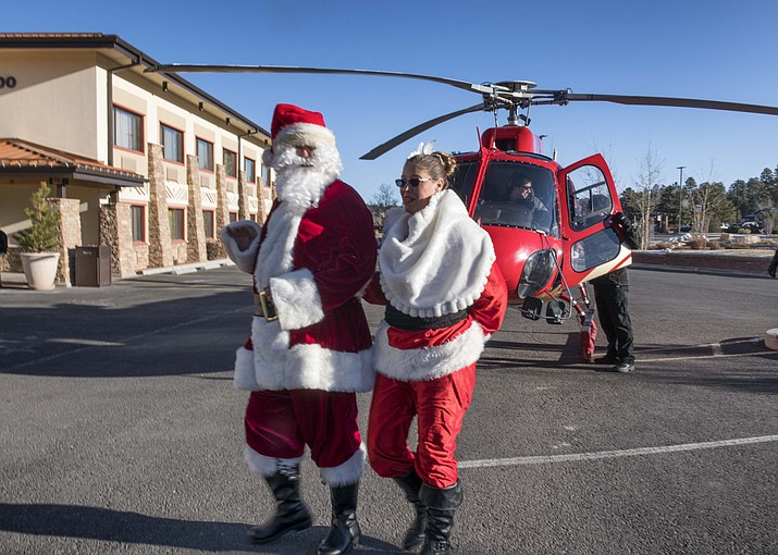 Santa and Mrs. Claus, played by Taylor Lipscomb and Tracy D'Albini, made a grand entrance via helicopter. (V. Ronnie Tierney/WGCN)