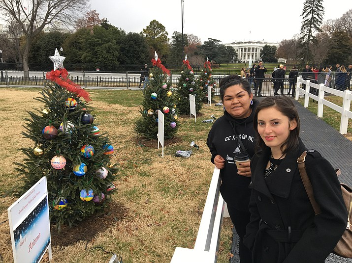 Madelynski Anthony and Gema Torres, along with art instructor Kristin Zanos, traveled from the Grand Canyon to Washington D.C. for the National Christmas Tree lighting Dec. 5. (Photo/Kristin Zanos)