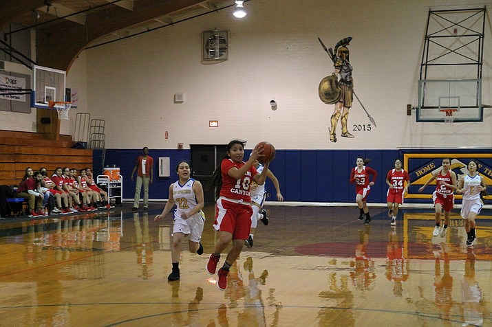 Savannah Longhoma catches a pass from Cayli Miles on a breakaway for an easy basket. (Erin Ford/WGCN)