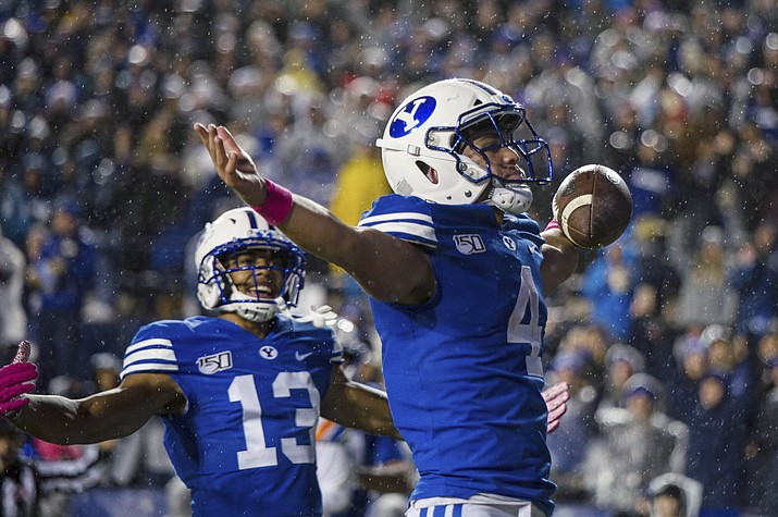 BYU running back Lopini Katoa (4) celebrates a touchdown in the first half of a game against Boise State on Saturday, Oct. 19, 2019, in Provo, Utah. (Tyler Tate/AP, file)